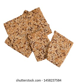 Healthy snack, wholemeal, wholewheat crackers with sunflower, linseed and sesame seeds. Isolated on white background.
