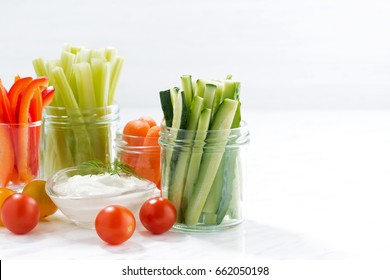 healthy snacks, mixed vegetables and yogurt and white background, horizontal