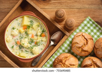 Healthy soup with cauliflower, carrot and potatoes.