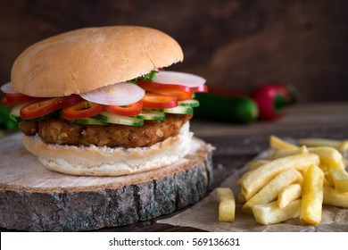 Healthy soy burger with fresh vegetables and french fries