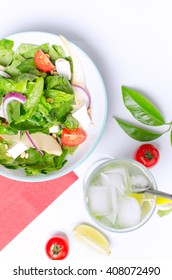 Healthy spinach salad with a top with a cocktail. Authentic fresh salad. Vegetable salad.