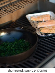 healthy spinach and salmon on the grill. vitamins and omega 3 fatty acids for a healthy diet nutrition
