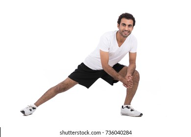 Healthy sportive man is warming up, isolated on white background.