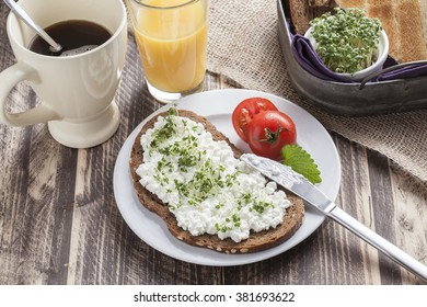 healthy spring summer low fat breakfast with orange juice,coffee,bread,cottage cheese, cress and tomatoes