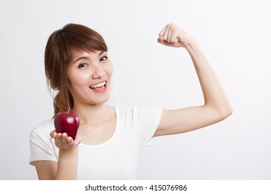 healthy, strong asian woman with red apple, looking at you