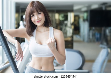 healthy strong fitness woman working out in gym. portrait of fitness woman forin gym posing for strong body, gym workout, fitness people, healthy lifestyle concept. asian adult fitness woman model