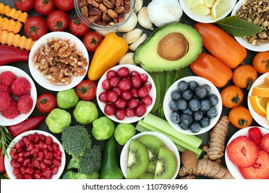 Healthy super food concept with vegetables, fruit, herbs, spice and nuts. Food very high in antioxidants, anthocyanins, omega 3, minerals and vitamins.