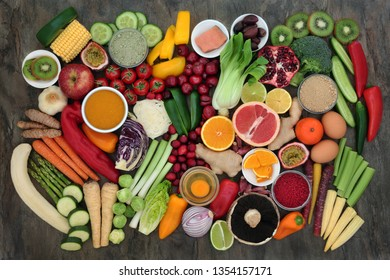 Healthy super food with fresh fish, fruit, vegetables, dairy, grains, supplement powders, herbs and spices. Very high in antioxidants, anthocyanins, protein, vitamins and dietary fibre. Top view.