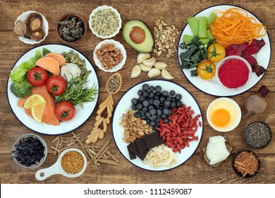 Healthy super food with health promoting properties to sharpen brain power and promote memory with foods high in omega 3, antioxidants, anthocyanins, vitamins and minerals. Top view.