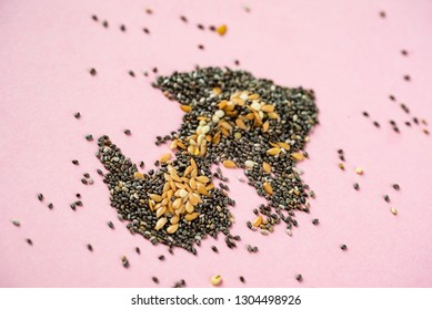 Healthy superfood:  flax seeds, chia seeds and hemp shelled seed on pink background
