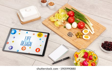 Healthy Tablet Pc compostion with LIFE DESIGN inscription, weight loss concept