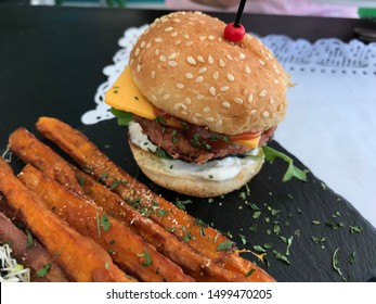 Healthy and tasty Vegan vegetarian lunch at the Spanish restaurant in Sotogrande Andalucia Spain. Herbs, sweet potato, pine nuts, sauce and tasty with Beyond Meat first plant-based vegan burger.