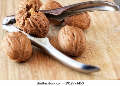 Healthy and tasty Walnuts and nutcracker on wooden board