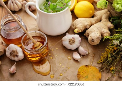 healthy tea with herbs, honey, ginger, garlic and lemon