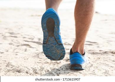 Healthy trail running on the beach coast