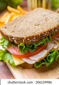 Healthy Turkey Breast, Ham, Cheese and Vegetables Sandwich on whole wheat bread