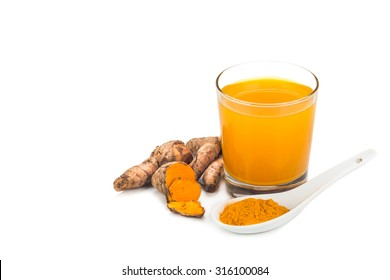 Healthy turmeric roots drinks in a transparent glass