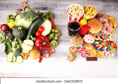 healthy or unhealthy food. Concept photo of healthy and unhealthy food. Fruits and vegetables vs donuts,sweets and burgers on table