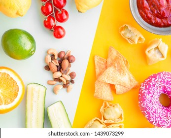 Healthy and unhealthy food, dieting concept. Fast food on yellow and green vegetables, nuts and fruits on light blue studio background with copy space. Flat lay, view from top.