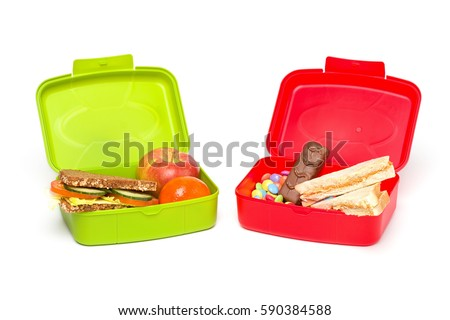 Healthy And Unhealthy School Lunch Box Isolated On White With Whole Grain Bread