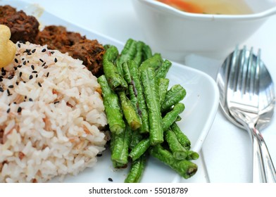Healthy unpolished red rice and beans. Suitable for concepts such as diet and nutrition, healthy lifestyle, and food and beverage.