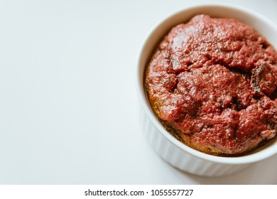 Healthy vegan beetroot muffin in white cup on white background. Festive composition, copy space available. Flat lay. Film effect.