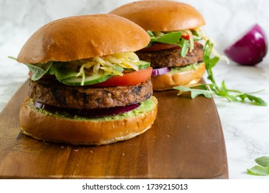 Healthy vegan burger with avocado,tomato ,onion.Mushroom burger. Basic and healthy food concept.
