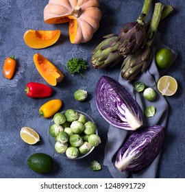 Healthy vegan cooking ingredients, fresh vegetables, clean eating concept, flat lay. red cabbage, artichokes, brussel sprouts, pumpkin, top view, square image