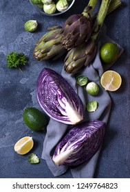 Healthy vegan cooking ingredients, fresh vegetables, clean eating concept, artichokes,brussel sprouts and red cabbage,