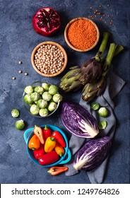 Healthy vegan cooking ingredients, fresh vegetables und legumes, clean eating concept
