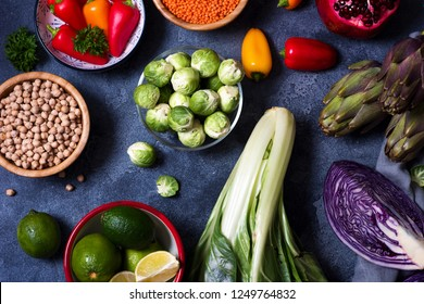 Healthy vegan cooking ingredients, fresh vegetables, clean eating concept, artichokes, mangold, brussel sprouts and red cabbage