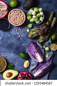 Healthy vegan cooking ingredients, fresh vegetables, artichokes,red cabbage, brussel sprouts, avocado, clean eating concept, flat lay