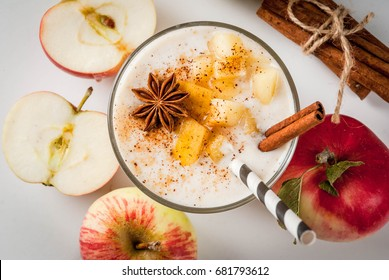 Healthy vegan food. Dietary breakfast or snack. Apple pie smoothies, with apples, yogurt, cinnamon, spices, walnuts. In a glass, on a white marble table. top view