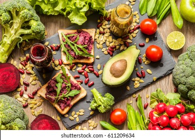 Healthy vegan food. Fresh vegetables on wooden background. Detox diet. Different colorful fresh juices. - Shutterstock ID 611209634
