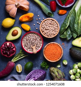 Healthy vegan food, quinoa, lentils, chickpeas, cooking ingredients with fresh vegetables, clean eating concept, artichokes, mangold, brussel sprouts and red cabbage, square image
