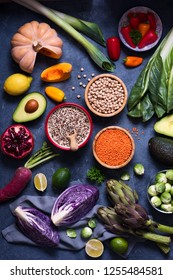 Healthy vegan food, quinoa, lentils, chickpeas, cooking ingredients with fresh vegetables, clean eating concept, artichokes, mangold, brussel sprouts and red cabbage