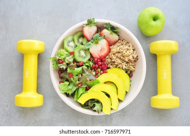 Healthy vegan lunch bowl. Avocado, quinoa,fruits and vegetables salad. Top view