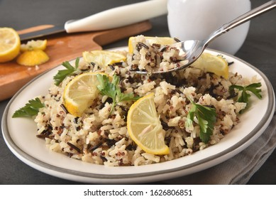 Healthy vegan meal of wild rice, brown rice and tricolor quinoa served with lemon and cilantro
