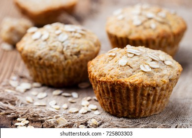 Healthy vegan oat muffins, apple and banana cakes on a wooden background. Copy space.