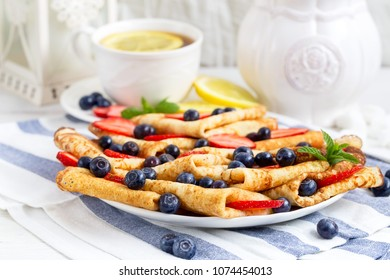 Healthy vegan pancakes crepe with blueberry and strawberry.