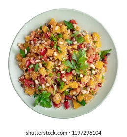 Healthy vegan salad with pumpkin and quinoa isolated on white, top view
