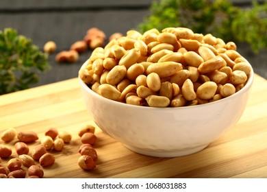 Healthy vegan snack food- salted organic peanuts.