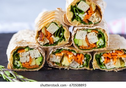 Healthy vegan tofu tortilla wraps with tofu and vegetables. Love for a healthy raw food concept.