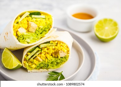 Healthy vegan wraps with bulgur and baked tofu. Healthy vegetarian food concept.