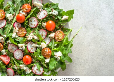 Healthy vegetable salad with fresh vegetables, vegetarian food on plate, top view