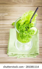 Healthy vegetable smoothie green juice on wooden table
