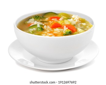 Healthy vegetable soup with rice in a white bowl with saucer. Side view isolated on a white background.