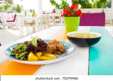 Healthy vegetables with meat on the plate in the restaurant with soup