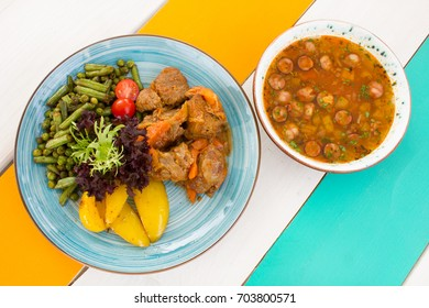 Healthy vegetables with meat on the plate with soup in the restaurant top view