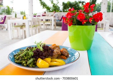 Healthy vegetables with meat on the plate in the restaurant